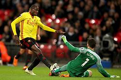 Watford's Abdoulaye Doucoure (left) and Tottenham Hotspur goalkeeper Hugo Lloris battle for the ball