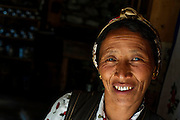 A Tamang woman in the doorway of a building in Langtang village, Langtang Valley, Nepal, 30th May 2009. <br /> <br /> According to Dorothea Stumm, a glaciologist at the Nepal-based International Centre for Integrated Mountain Development, a massive hanging glacier cracked when an earthquake struck at 11.56am on the 25th April 2015. The ice formed a cloud that gathered snow and rocks and then funnelled down the mountain, burying Langtang village, and creating an enormous pressurised blast. 400 residents of the village and up to 100 trekkers are believed to have been killed.<br /> <br /> PHOTOGRAPH BY AND COPYRIGHT OF SIMON DE TREY-WHITE<br /> <br /> + 91 98103 99809<br /> email: simon@simondetreywhite.com<br /> photographer in delhi