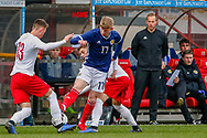 Stuart Mckinstry (Motherwell) wins a 50/50 ball against Jakub Iskra during the U17 European Championships match between Scotland and Poland at Firhill Stadium, Maryhill, Scotland on 26 March 2019.