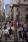 Commuters and lunchtime pedestrians enter and leave Bank Underground station on the corner of Lombard and King William Streets on 12th September, in the capitals financial district, the City of London, UK.