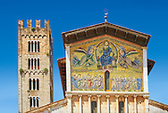 Close up of the campinale & Facade with Byzantine Mosaic panel depicting Christ Pantocrator of the Basilica of San Frediano, a Romanesque church, Lucca, Tunscany, Italy .<br /> <br /> Visit our BYZANTINE MOSAIC PHOTO COLLECTION for more   photos  to download or buy as prints https://funkystock.photoshelter.com/gallery/Byzantine-Eastern-Roman-Style-Mosaics-Pictures-Images/G0000NvKCna.AoH4/3/C0000YpKXiAHnG2k<br /> If you prefer to buy from our ALAMY PHOTO LIBRARY  Collection visit : https://www.alamy.com/portfolio/paul-williams-funkystock/lucca.html If you prefer to buy from our ALAMY PHOTO LIBRARY  Collection visit : https://www.alamy.com/portfolio/paul-williams-funkystock/lucca.html .