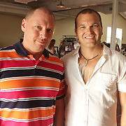 Les Rutt, left, and Jeremy Rowley pose for a photo during Fashion On Front Thursday August 21, 2014 at Bakery 105 in Wilmington, N.C.(Jason A. Frizzelle)