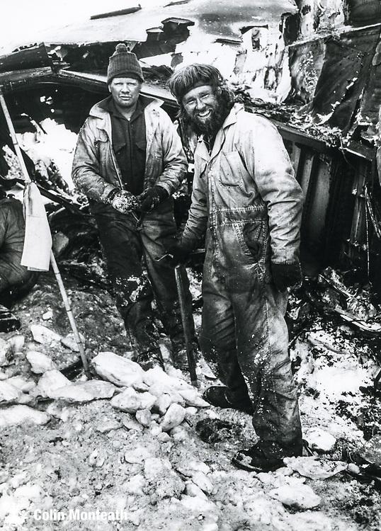 NZ policeman Al Swindelburn (left) & Antarctic Division DSIR mountaineer Roy Arbon beside main fuselage on final day recovery operation, Air New Zealand crash site, Ross Island, December 1979