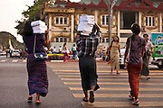 A group of people carry books through the streets of Yangon, Burma.<br /> Note: These images are not distributed or sold in Portugal