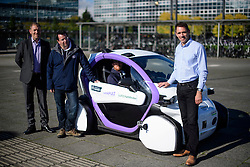 © London News Pictures. 11/10/2016. Milton Keynes, UK. Dr Graeme Smith, CEO and chairman of Oxbotica (right) watches over as driverless cars are tested around pedestrian areas in Milton Keynes in the first public test of autonomous electric vehicles in the UK. The vehicles have been developed by the Oxford Robotics Institute and Oxbotica. Photo credit: Ben Cawthra/LNP