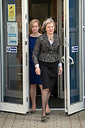 © Licensed to London News Pictures. 01/04/2015. Abingdon, UK. NICOLA BLACKWOOD, THERESA MAY. Home secretary, Theresa May and Nicola Blackwood, Parliamentary candidate for Abingdon visit Abingdon Police Station today, 1st April 2015, recent arrests for human exploitation, slavery and fraud. . Photo credit : Stephen Simpson/LNP