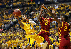 Feb 24, 2018; Morgantown, WV, USA; West Virginia Mountaineers guard Daxter Miles Jr. (4) shoots in the lane during the second half against the Iowa State Cyclones at WVU Coliseum. Mandatory Credit: Ben Queen-USA TODAY Sports