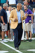 Former Tampa Bay Buccaneers and Indianapolis Colts head coach Tony Dungy gives a thumbs up while being announced over the public address system as he walks onto the field as a new member of the Pro Football Hall of Fame before the Green Bay Packers 2016 NFL Pro Football Hall of Fame preseason football game against the Indianapolis Colts on Sunday, Aug. 7, 2016 in Canton, Ohio. The game was canceled for player safety reasons due to the condition of the paint on the turf field. (©Paul Anthony Spinelli)