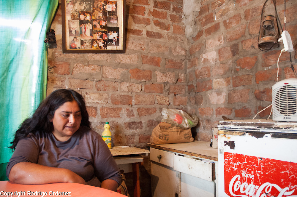 """Mónica 'Cori' Jiménez is a single mother with five children. """"I grew up alone, in the streets,"""" she said. """"I never stole anything and I never took drugs."""" She survives on government assistance and the community soup kitchen. """"If it didn't exist, I don't know what would have happened to my life and to the lives of my children."""" <br /> She used to be a 'cartonera' in downtown Buenos Aires for 15 years. She used to take her children out to beg until, in an argument, her older daughter convinced her that it was wrong. Cori combed trash at the municipal trash dump for three months, but she says she stopped because police beat her often and once shot her in the leg with a rubber bullet. After a childhood of mistreatment, Cori hopes life in 8 de Mayo will offer something better to her kids. <br /> """"I am 30 and I already want to die,"""" she told a visitor, slowly and deliberately, with her eyes fixed on the ground. """"I want my children to be someone in life."""""""