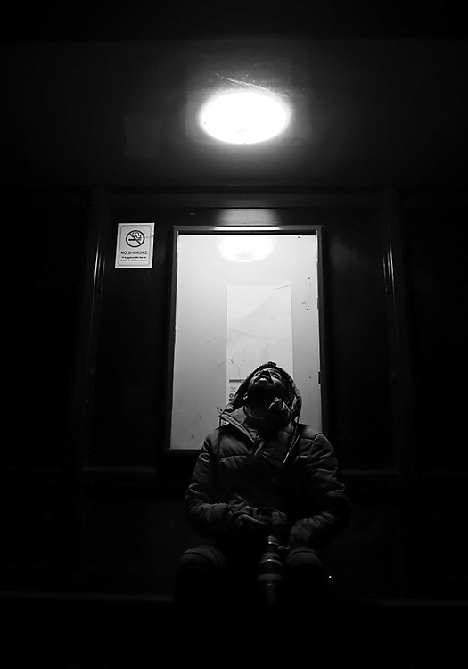 Student Amir Farjam is pictured at a bus stop in Cheltenham, Gloucestershire during the second national lockdown during the Coronavirus Pandemic