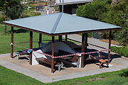 Sydney, Australia.Saturday 18th April 2020. Tamarama Beach in Sydney's eastern suburbs closed due to the Coronavirus Pandemic. From yesterday Tamarama beach was reopened for swimming and surfing. A picnic area closed off while someone exercises.