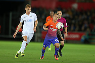 Jose Tasende of Manchester city gets away from Jay Fulton of Swansea city (l), EFL Cup. 3rd round match, Swansea city v Manchester city at the Liberty Stadium in Swansea, South Wales on Wednesday 21st September 2016.<br /> pic by  Andrew Orchard, Andrew Orchard sports photography.