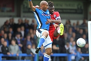 Calvin Andrew challenged by Gabriel Zakuani during the EFL Sky Bet League 1 match between Rochdale and Gillingham at Spotland, Rochdale, England on 23 September 2017. Photo by Daniel Youngs.