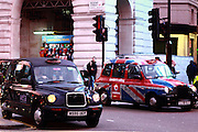 London Cabs at the junction of Regent Street and Piccadilly Circus.