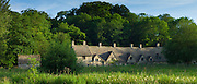 Arlington Row cottages traditional almshouses in Bibury, Gloucestershire in The Cotswolds, UK