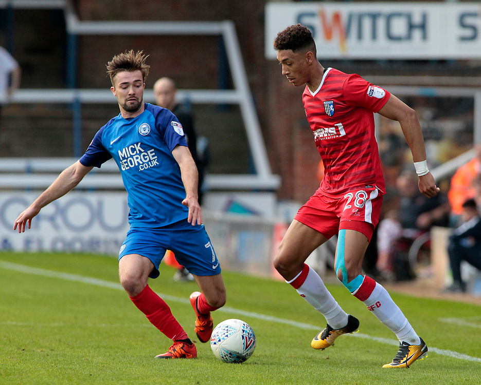 Gillingham's Sean Clare battles with Peterborough United's Gwion Edwards<br /> <br /> Photographer David Shipman/CameraSport<br /> <br /> The EFL Sky Bet League One - Peterborough United v Gillingham - Saturday 14th October 2017 - London Road Stadium - Peterborough<br /> <br /> World Copyright © 2017 CameraSport. All rights reserved. 43 Linden Ave. Countesthorpe. Leicester. England. LE8 5PG - Tel: +44 (0) 116 277 4147 - admin@camerasport.com - www.camerasport.com