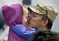 A daughter gets her birthday wish, her daddy comes home.  Darren Stewart <cq>, a TSGT with the 6th Air Refueling Sqaudron, 60th Air Mobility Wing gives his daughter Sydney Stewart a kiss after arriving home from duty in the Persian Gulf region. Tuesday, April 29, 2003.   Stewart was greeted by his wife, Amy and their two children.  They live on-base at Travis.