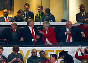 ATLANTA, GA - JANUARY 08: U.S. President Donald Trump sits with the United States Secretary of Agriculture, Sonny Perdue, during the game between the Georgia Bulldogs and Alabama Crimson Tide in the CFP National Championship presented by AT&T at Mercedes-Benz Stadium on January 8, 2018 in Atlanta, Georgia. (Photo by Mike Zarrilli/Getty Images)