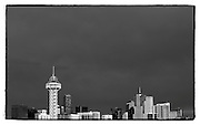 SHOT 3/31/10 5:49:40 PM - A black and white image of the downtown Denver, Co. skyline as the sun sets one evening.  (Photo by Marc Piscotty / © 2010)