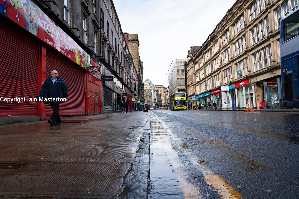 Glasgow, Scotland, UK. 12 March 2021. On the day Covid-19 lockdown is relaxed slightly in Scotland the city centre streets in Glasgow city centre remain almost deserted virtually all shops ad cafes are still closed. Pic;  Union Street is almost deserted with all shops closed. Iain Masterton/Alamy Live News