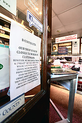 Covid 19 - Sign in a butchers shop window in a market town in Dorset during lock down, UK March 2020