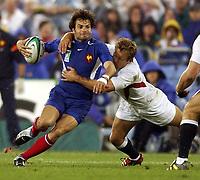 Photo: Richard Lane.<br />France v England. Semi-Final, at the Telstra Stadium, Sydney. RWC 2003. 16/11/2003. <br />Chrfistophe Dominici is tackled by Jonny Wilkinson.