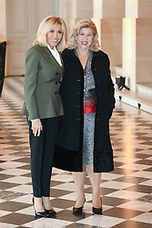 French President's wife Brigitte Macron welcomes Ivory Coast's President wife Dominique Ouattara as they take part in a spousal event at the Chateau de Versailles in Versailles, near Paris, on November 11, 2018 as part of commemorations marking the 100th anniversary of the 11 November 1918 armistice, ending World War I. Photo By Laurent Zabulon/ABACAPRESS.COM