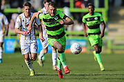 Forest Green Rovers Christian Doidge(9) runs forward during the EFL Sky Bet League 2 match between Forest Green Rovers and Milton Keynes Dons at the New Lawn, Forest Green, United Kingdom on 30 March 2019.