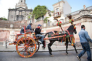 Traditional hand carved and painted Sicilian carts are collected and still used during festivals. Trecastagni, eastern Sicily.