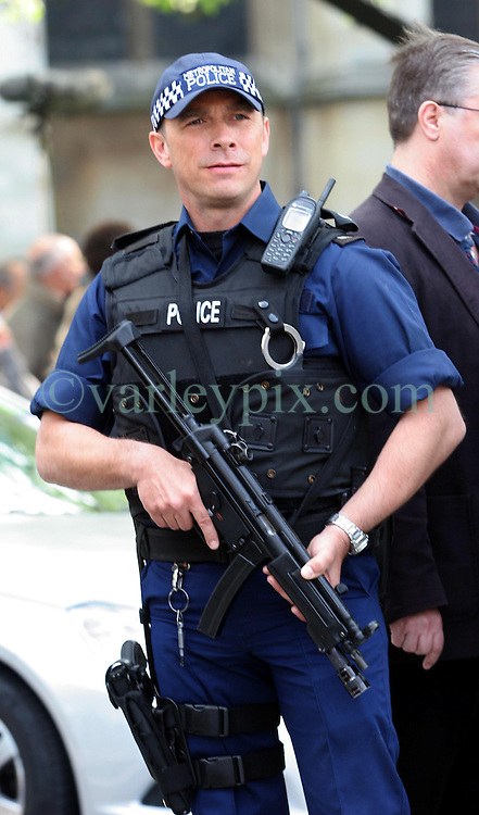 28 April 2011. London, England..Armed police outside Westminster Abbey monitor the growing crowds. The Met have an enormous security operation in place to protect the royal couple and dignitaries from all around the world. Prince William is set to marry his bride Catherine Middleton on Friday, April 29th. .Photo; Charlie Varley.