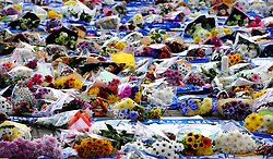 Flower tributes are seen outside Leicester City Football Club after a helicopter crashed Saturday killing Leicester City's owner, Thai billionaire Vichai Srivaddhanaprabha and four other people, in Leicester, England, Monday Oct. 29 2018. The helicopter crashed in flames in a car park next to the soccer club's stadium shortly after it took off from the pitch following a Premier League game on Saturday night. (AP Photo/Rui Vieira)