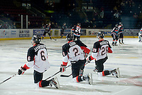 KELOWNA, CANADA, DECEMBER 3: Jesse Forsber #6, Daniel Gibb #2, and Martin Marincin #28 of the Prince George Cougars warm up on the ice as the Prince George Cougars visit the Kelowna Rockets  on December 3, 2011 at Prospera Place in Kelowna, British Columbia, Canada (Photo by Marissa Baecker/Shoot the Breeze) *** Local Caption ***