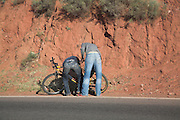 Two men fixing bicycle, Atlas Mountains, Morocco