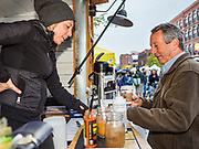 19 OCTOBER 2019 - DES MOINES, IOWA: MARK SANFORD (R-SC), right, talks to a coffee seller in the Des Moines Farmers' Market during a campaign visit to the market Saturday. Sanford, a former Republican governor and Congressman from South Carolina, is challenging incumbent President Donald Trump for the Republican nomination for the US presidency. Iowa hosts the first event of the presidential selection cycle. The Iowa Caucuses are scheduled for February 3, 2020.              PHOTO BY JACK KURTZ