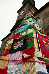 A Community Yarn Christmas Tree has been installed outside the Bellfield Community Centre in Portobello Edinburgh. Locals are encouaged to bring their own wool creations to add to the lower part of the tree and add to display.<br /> <br /> <br /> © Jon Davey/ EEm