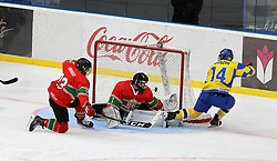 April 17, 2018 - Kyiv, Ukraine - Defenceman Mate Seregely (L) of Hungary and forward Feliks Morozov (R) of Ukraine are seen in action as goaltender Lajos Gonczi (C) of Hungary misses the puck during the 2018 IIHF Ice Hockey U18 World Championship Division I Group B Round Robin match at the Palace of Sports in Kyiv, capital of Ukraine, April 17, 2018. Ukrinform. (Credit Image: © Danil Shamkin/Ukrinform via ZUMA Wire)