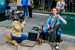 Paisley born cellist/singer/songwriter CALUM INGRAM playing cello in Buchanan Street Glasgow while being filmed for a documentary.<br /> <br /> (c) Andrew Wilson | Edinburgh Elite media