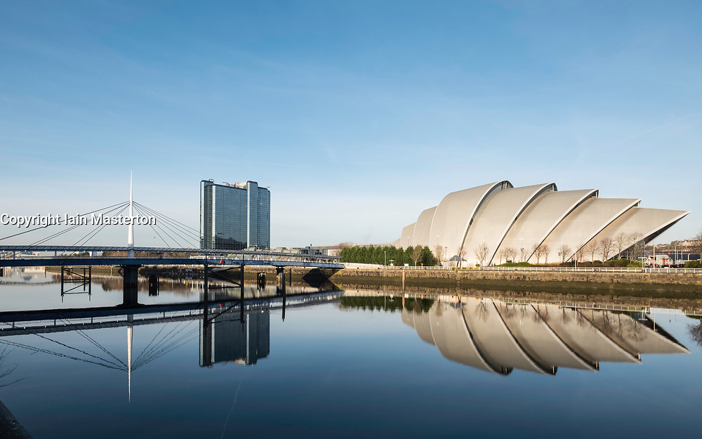 View of Bells Bridge, SEC Armadillo and SE Hydro beside River Clyde on blue sky wintery day, Scotland, United Kingdom