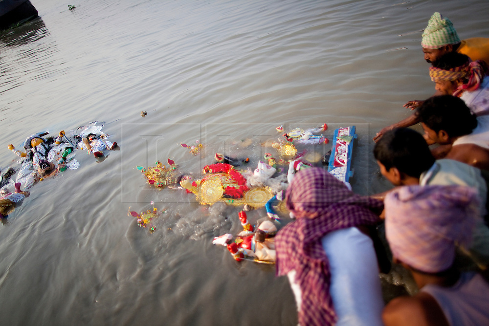 © under license to London News Pictures.  17/10/2010 ©London News Pictures. 17/10/2010.  idols of Hindu goddess Durga float  of in the river Ganges on the last day of the Durga Puja festival on October 17, 2010 in Kolkata, India. The festival is the biggest of the year in the Indian state of Bengal and celebrates the worship of the Hindu Goddess Durga, who in Hindu Mythology is celebrated as the Goddess of power and the victor of good over evil.