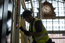 © Licensed to London News Pictures. 09/04/2020. Manchester, UK. A contractor carries out specialised purged nitrogen welding on oxygen pipes . The National Health Service is building a 648 bed field hospital for the treatment of Covid-19 patients , at the historical railway station terminus which now forms the main hall of the Manchester Central Convention Centre . The facility is due to open on Easter Monday , 13th April 2020 , and will treat patients from across the North West of England , providing them with general medical care and oxygen therapy after discharge from Intensive Care Units . Photo credit: Joel Goodman/LNP