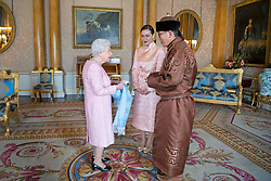 Narkhuu Tulga (left), Ambassador of Mongolia, accompanied by Burmaa Batbold, presents his credentials to Queen Elizabeth II during a private audience at Buckingham Palace, London.