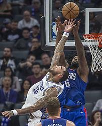November 25, 2017 - Sacramento, CA, USA - The Sacramento Kings' Willie Cauley-Stein (00) blocks a pass to the Los Angeles Clippers' DeAndre Jordan (6) in the first half on Saturday, Nov. 25, 2017, at Golden 1 Center in Sacramento, Calif. (Credit Image: © Hector Amezcua/TNS via ZUMA Wire)