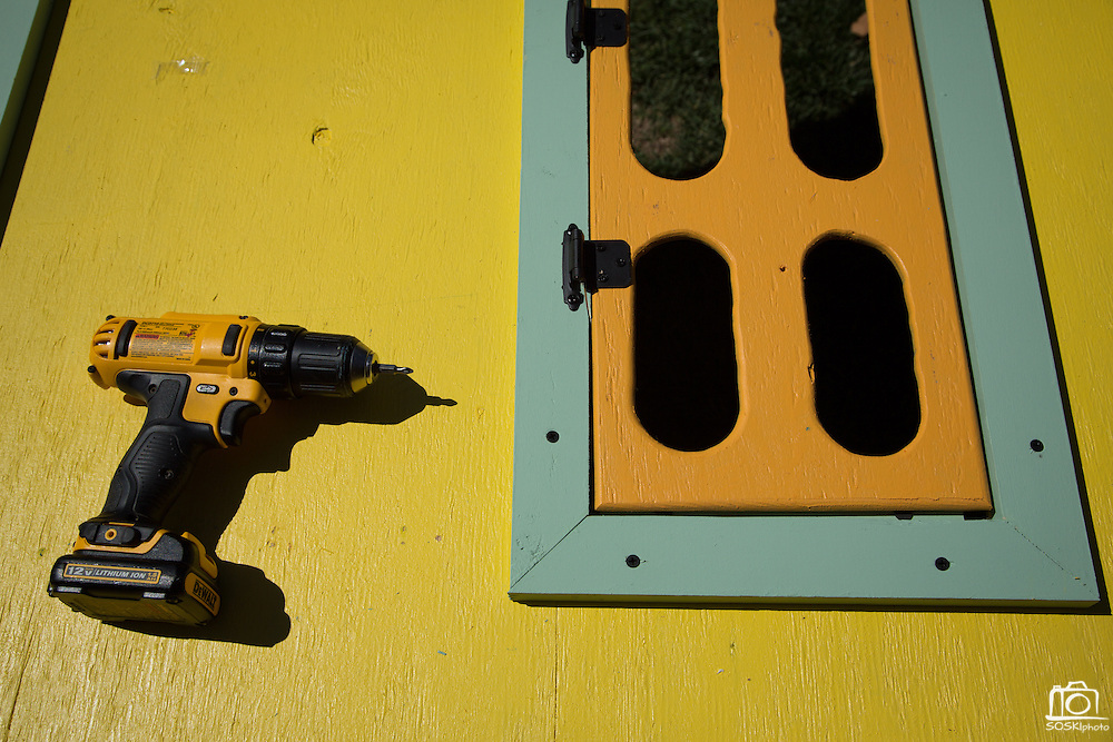 A power drill lays on top a playhouse wall during a Habitat for Humanity playhouse build at the SanDisk headquarters in Milpitas, California, on August 27, 2013. (Stan Olszewski/SOSKIphoto)