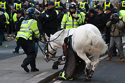 © under license to London News Pictures. 9/12/2010. A police horse is brought under control after loosing it's mount. On the day that MPs vote on tuition fees, 1000s demonstrated in London against a proposed rise in fees and cuts in support. Credit should read Matt Cetti-Roberts/London News Pictures