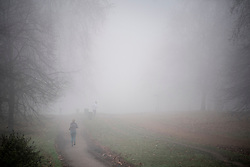 © Licensed to London News Pictures. 17/12/2016. London, UK. Joggers in Hyde Park in the fog.  Parts of the UK are swathed in thick fog this morning. Photo credit: Ben Cawthra/LNP