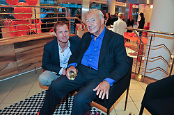 Left to right, TOM CONRAN and SIR TERENCE CONRAN at an exhibition at The Conran Shop entitled Red to celebrate 25 years of The Conran Shop at the Michelin Building, 81 Fulham Road, London on 19th September 2012.