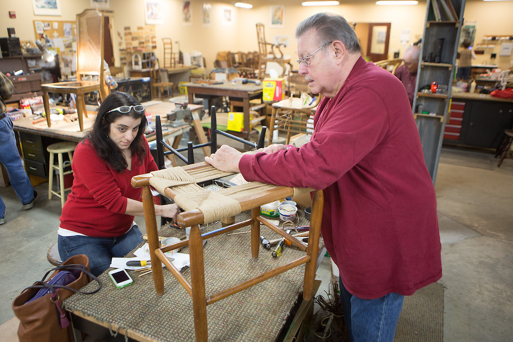 Esther Bondy of Short Hills and Tom O'Brien of Scotch Plains restore chairs at the Sage Eldercare furniture restoration workshop in Summit.  1/5/14 Photo by John O'Boyle