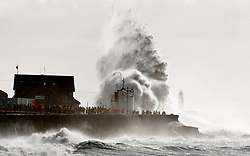 © Licensed to London News Pictures. 02/11/2019. Porthcawl, UK. Massive waves crash against the harbour wall as gale force winds and rain lash the seaside resort of Porthcawl in Bridgend, UK. Photo credit: Graham M. Lawrence/LNP