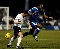 Photo: Daniel Hambury.<br />Luton Town v Cardiff City. Coca Cola Championship. 14/02/2006.<br />Luton's Sol Davis stops Cardiff's Cameron Jerome.
