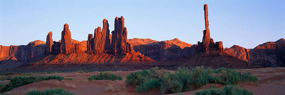 ARIZONA, MONUMENT VALLEY sand dunes at Totem Pole Rock